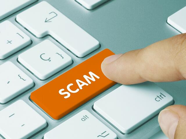 Business Email Compromise (BEC) scam on enter button of keyboard