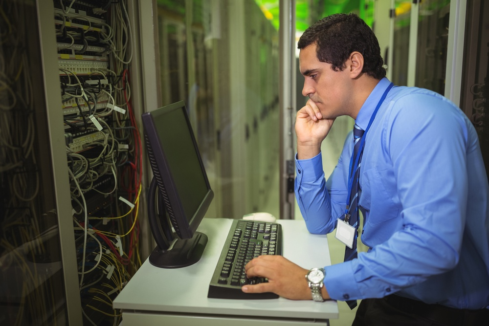 IT engineer monitoring network in server room