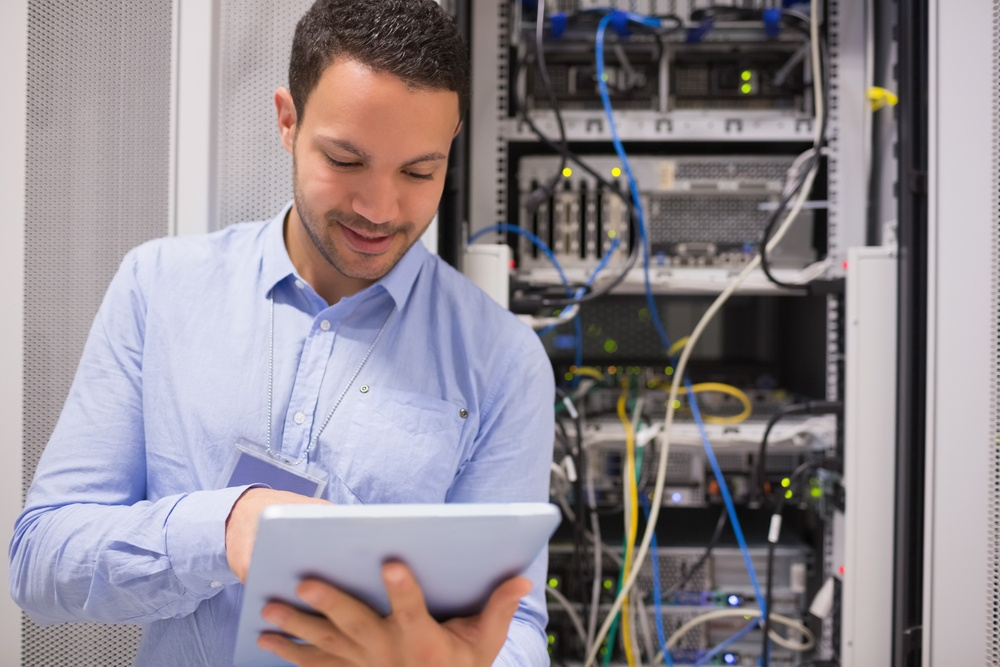 Man with tablet computer in data center IT management