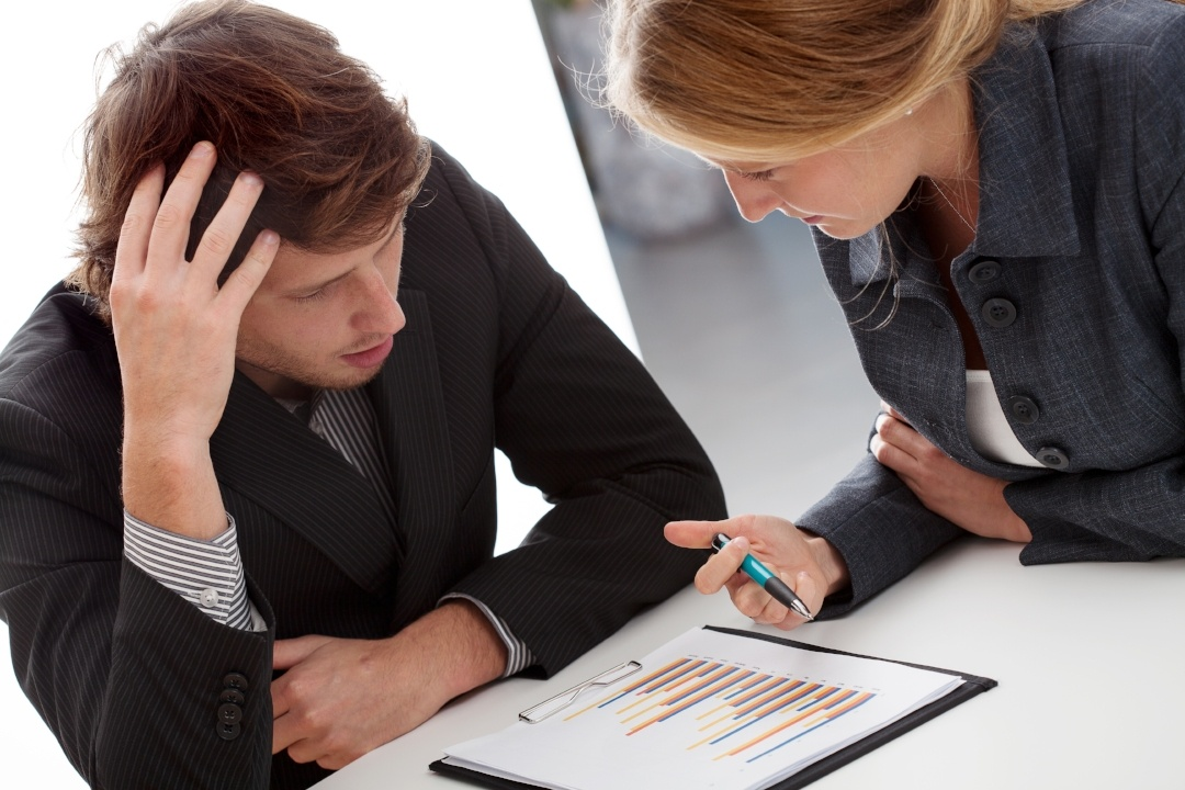 Business individuals struggling with collaboration