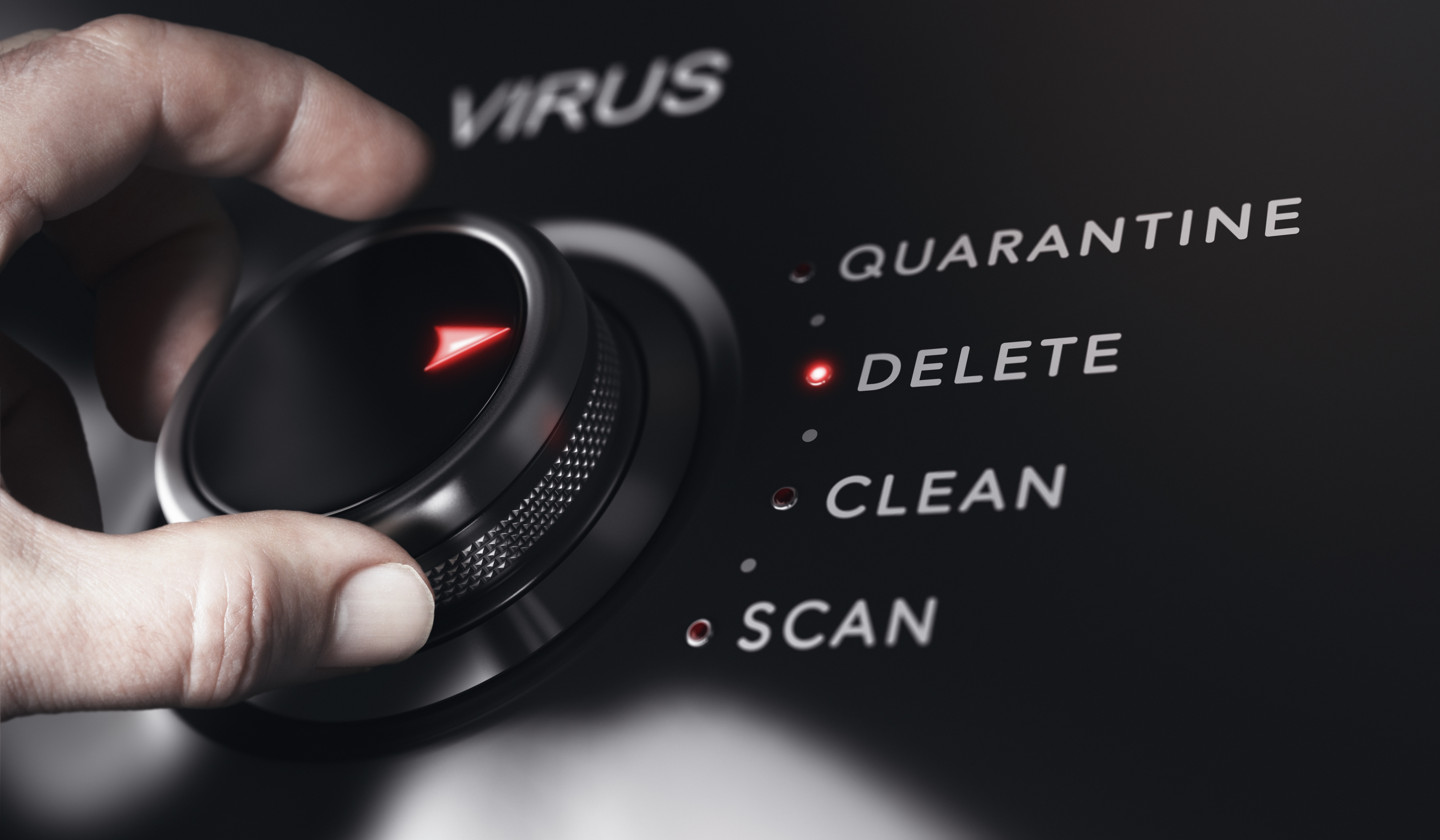 hand turning dial to delete, quarantine, clean, or scan a possible IT network virus advanced endpoint protection antivirus
